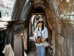 Sonya reading the guide book at Phimeanakas Temple