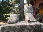 The feet of a statue at Preah Palilay Temple