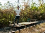 Our bamboo train driver waiting for the other train to pass