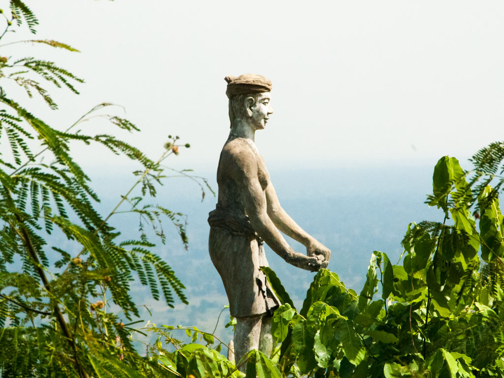 Statue sticking out of the lush canopy