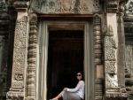Sonya reclining in one of the doorways of the temple