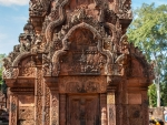 The intricate reliefs carving of red coloured stone