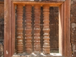 Carved column windows mimicking lathed wood