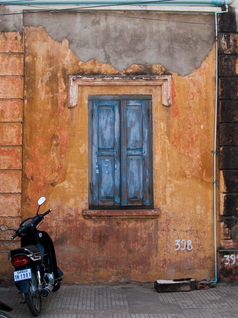 Dilapidated French style windows in Battambang