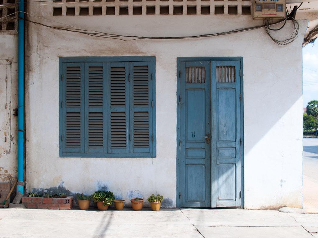 Blue door and window on one of the corner shops
