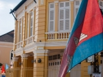 Cambodian flag outside Corner Building and Villa