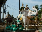 White elephant statues surrounding Wat Damrey Sor