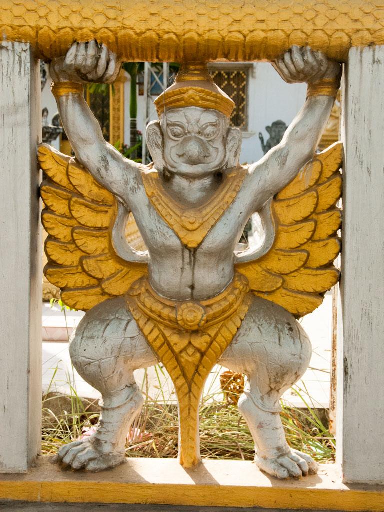 Garuda carved into the fence of Wat Kamphaeng