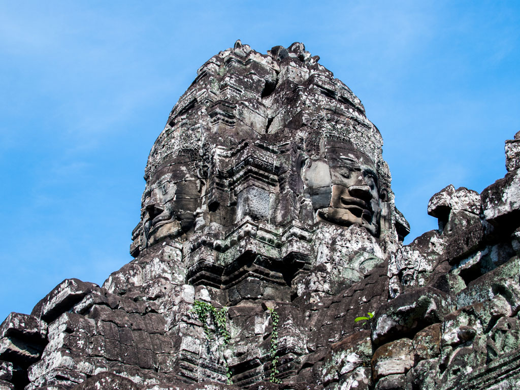 One of the multitude of serene and massive stone faces at Bayon