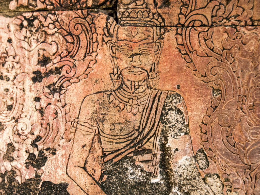 Buddhist figure in carved wall
