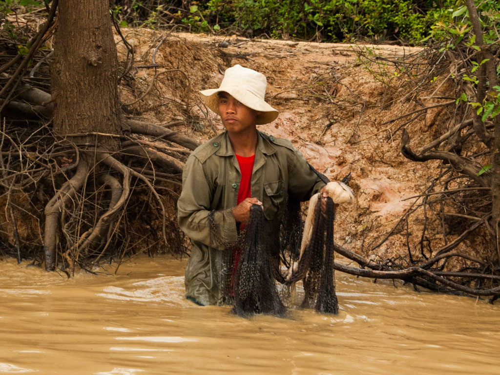 Fisherman about to cast his net