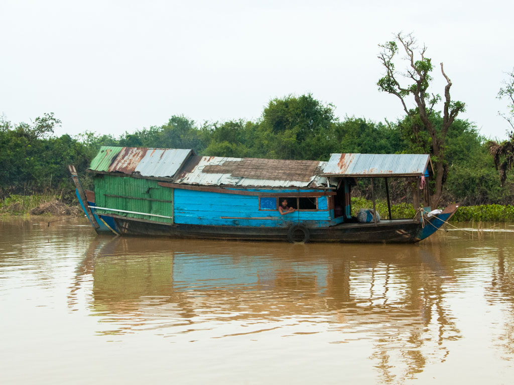 Boat on one of the tributaries feeding into Tonle Sap Lake