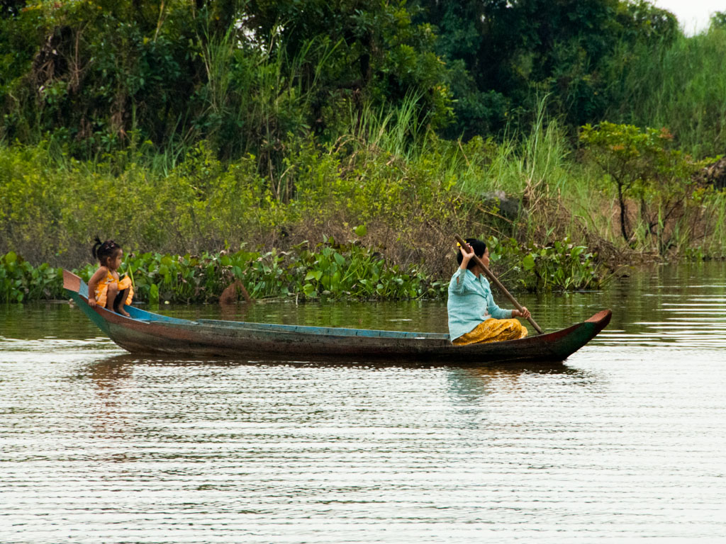 Mother and daughter on wooden canoe