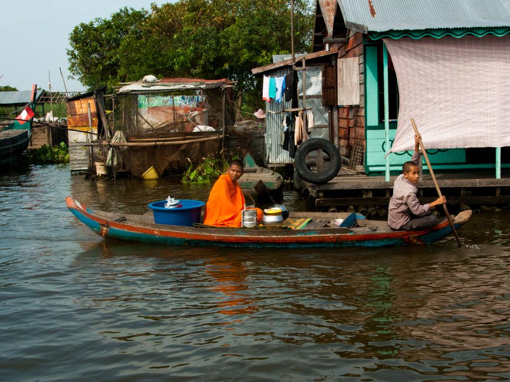 Monk in traditional orange on Stoeng Sangke river