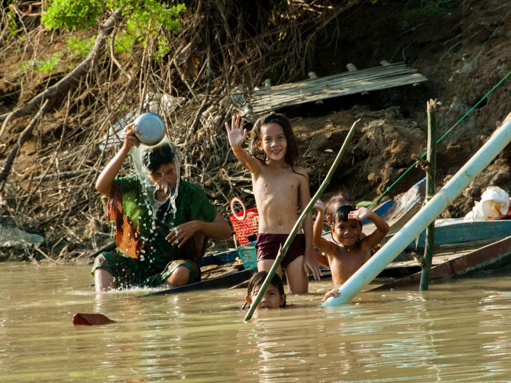 Children waving along the Sangker River
