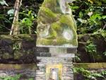 monkey-forest-ubud-bali-indonesia-c-monkey-at-the-base-of-a-monkey-statue