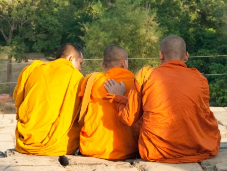 Monks sitting at Phnom Bakheng
