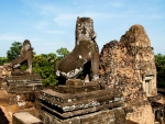 Mythical lions with the towers in the background