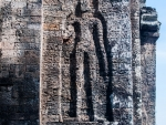 Simple person figure carved into the tower's bricks