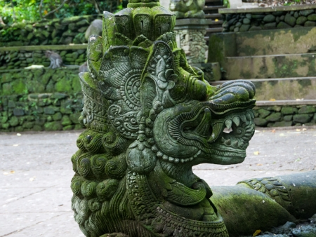 Ancient intricately carved stone with moss growing