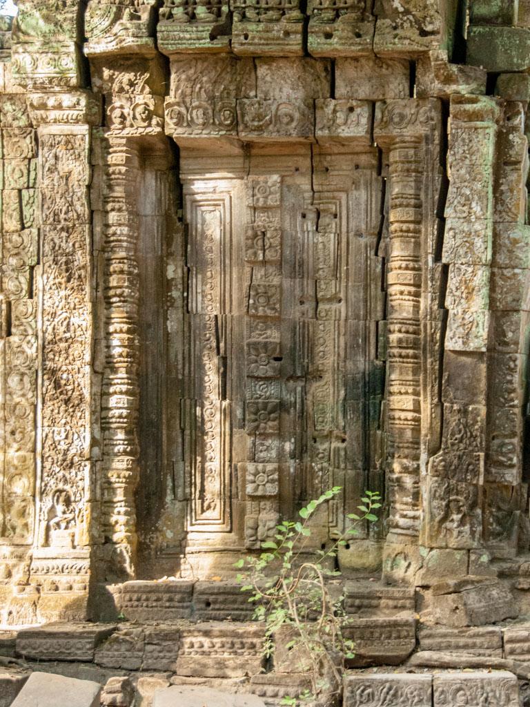 Carved stone door