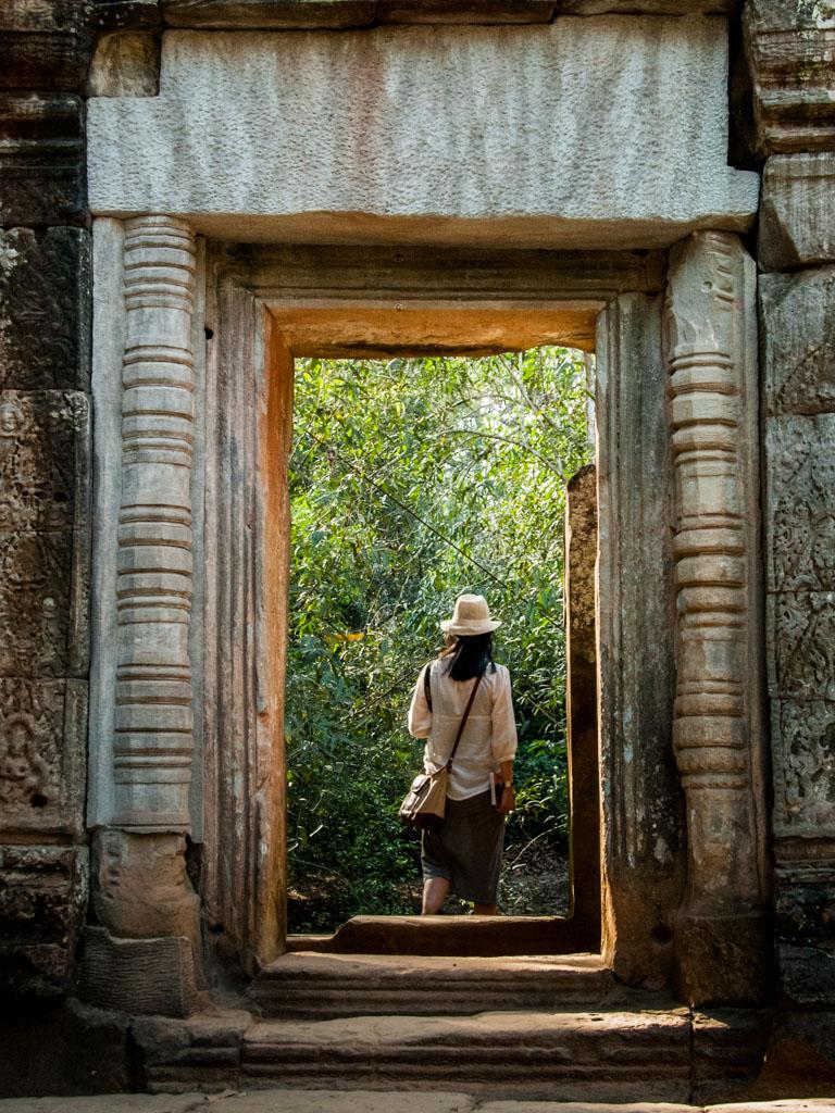 Sonya walking though a stone arch