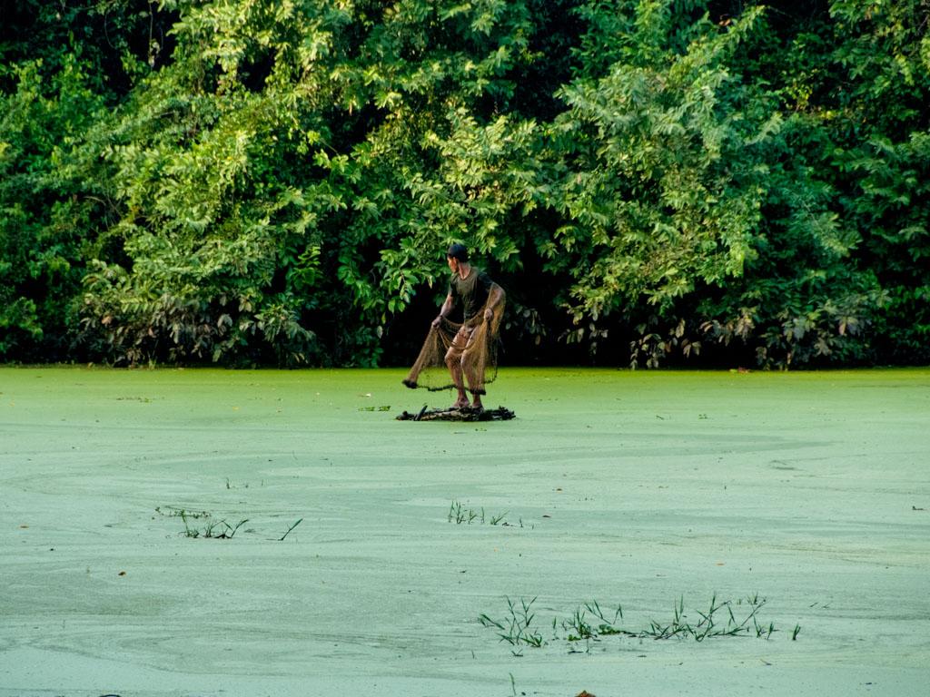 Cambodian man fishing on a small island