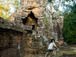 Sonya riding around Banteay Kdei Temple
