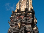 ubud-city-bali-indonesia-pura-saraswati-y-gold-gilding-at-the-top-of-the-carved-stone