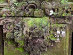 ubud-city-bali-indonesia-ubud-palace-h-green-moss-growing-on-a-stone-carving
