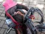 ubud-city-bali-indonesia-ubud-palace-l-farah-taking-a-break-and-sleeping-in-the-backpack