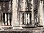 Intricate stone carved windows mimicking the look of wood