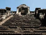 The very steep stairways represent the difficulty of ascending to the kingdom of the gods