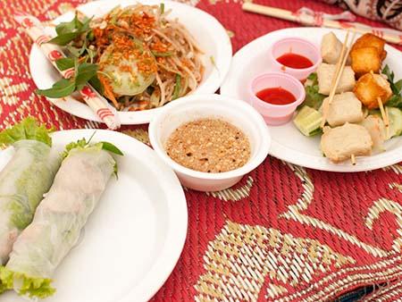 An assortment of Cambodian foods, rice paper rolls and papaya salad