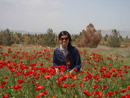 Sonya in a field of poppies