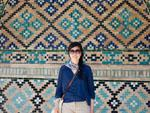 Sonya in front of the blue mosaics