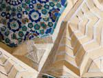 Intricate interior arch designs of Kukeldash Medressa