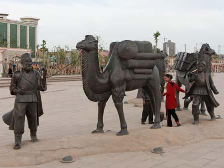 Statues reflecting travellers on the old Silk Road