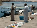 Egyptians selling souvenirs on the ferry jetty to Philae