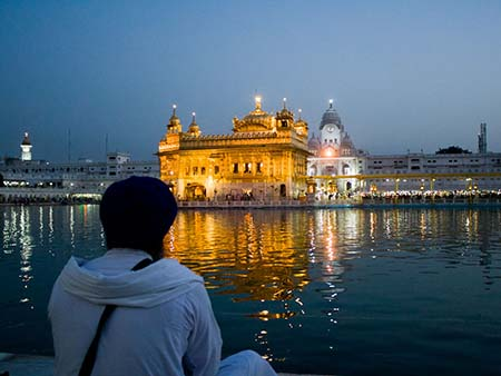Sikh pilgrim viewing the Golden Temple