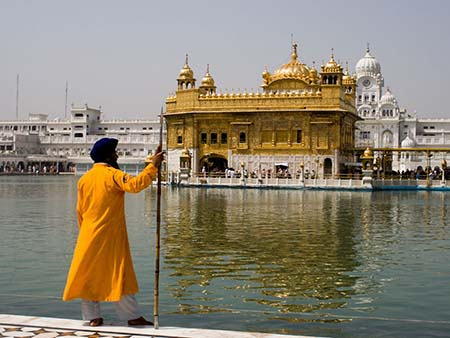 Sikh man in traditional dress and turban at the Golden Temple