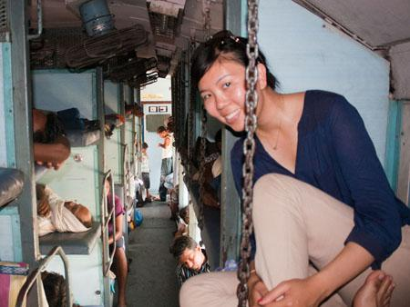 India train, Sonya sitting on the upper bunk