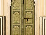 Beautiful decorated green wooden door