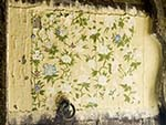 Peeling floral painting on a wooden door