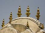Decorative golden features on the roof of the Hawa Mahal