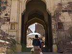 Sonya walking through the main multi gates of Dodh Kangra Pol entrance to Mehrangarh Fort