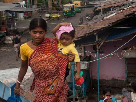A mother and child along Rash Behari Ave