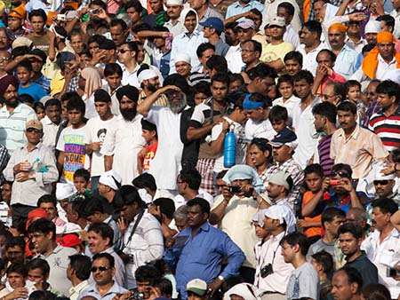 The mens section of the grandstands waiting for the show