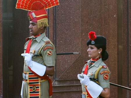 Two Indian guards waiting for the lowering of the flags