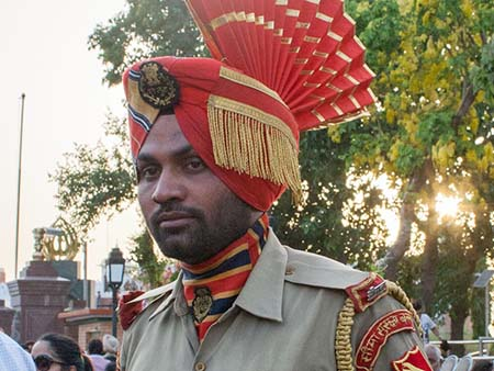 Indian guard wearing official uniform and headwear
